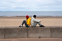 Edinburgh, Scotland, UK. 31 March, 2020. Despite Coronavirus lockdown members of the public are outside exercising and relaxing on Portobello promenade in Edinburgh. Iain Masterton/Alamy Live News