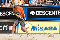 Boy preparing boarder line of court at A1 Beach Volleyball Grand Slam tournament of Swatch FIVB World Tour 2010, on July 28, 2010 in Klagenfurt, Austria. (Photo by Matic Klansek Velej / Sportida)
