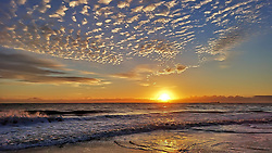 © Licensed to London News Pictures. 28/09/2018. Whitley Bay, UK. Beautiful cloud formations herald the sunrise over Whitley Bay on the North East coast. Photo credit: Colin Scarr/LNP