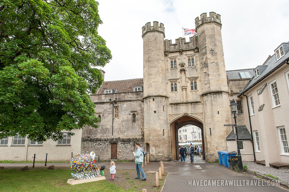 Looking out through the main gate of  Bishop Palace in Wells, Somerset, England, toward Market Place.