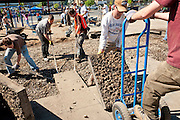 Volunteers working with the Portland Oregon nonprofit group Depave remove asphalt and concrete from parking lots in order to create gardens and playgrounds that foster both a higher quality of life and also better stormwater drainage, averting polluted, toxic runoff from streams and rivers. ** See accompanying text story within picture package.