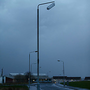 Storm Gertrude.  A street lamp hangs precariously outside Cranhill Primary School in Glasgow. Picture Robert Perry 29th Jan 2016<br /> <br /> Must credit photo to Robert Perry<br /> FEE PAYABLE FOR REPRO USE<br /> FEE PAYABLE FOR ALL INTERNET USE<br /> www.robertperry.co.uk<br /> NB -This image is not to be distributed without the prior consent of the copyright holder.<br /> in using this image you agree to abide by terms and conditions as stated in this caption.<br /> All monies payable to Robert Perry<br /> <br /> (PLEASE DO NOT REMOVE THIS CAPTION)<br /> This image is intended for Editorial use (e.g. news). Any commercial or promotional use requires additional clearance. <br /> Copyright 2014 All rights protected.<br /> first use only<br /> contact details<br /> Robert Perry     <br /> 07702 631 477<br /> robertperryphotos@gmail.com<br /> no internet usage without prior consent.         <br /> Robert Perry reserves the right to pursue unauthorised use of this image . If you violate my intellectual property you may be liable for  damages, loss of income, and profits you derive from the use of this image.