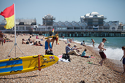 © Licensed to London News Pictures. 19/07/2016. Southsea, United Kingdom.  People enjoying the hot weather on Southsea beach this afternoon, 19th July 2016. Photo credit: Rob Arnold/LNP