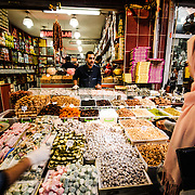 A customer buys Turkish Delight (Lokum) and other sweets from merchants at a confection shop in the Spice Bazaar (also known as the Egyption Bazaar) in Istanbul, Turkey.