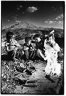 CHOMAN, KURDISTAN, IRAQ, OCTOBER 1993. Young children break open ammunition and set fire to the powder. Twenty million landmines and unexploded ordnance litter the former frontline in the Iran vs Iraq War still killing and maim ing Kurdish people on a daily basis.©Photo by Frits Meyst/NewsImages