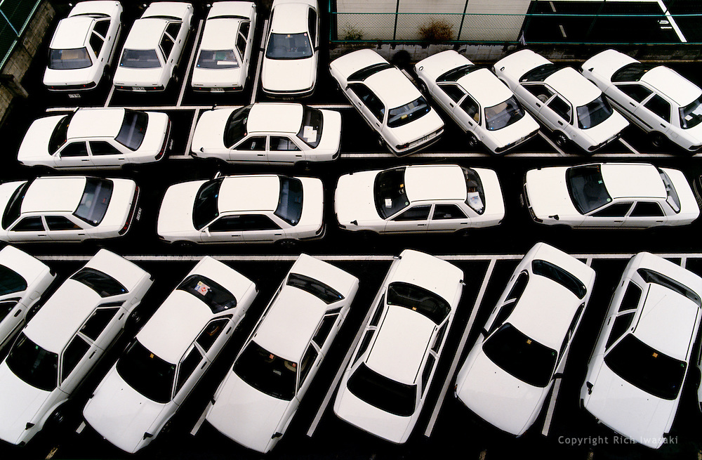 High angle view of company cars in the parking lot of publishing company, Hiroshima city, Hiroshima Prefecture, Japan