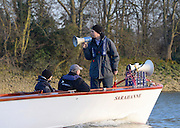 Putney LONDON. Standing, Richard PHELPS, umpire, issues instructions to the following flotilla, during the Oxford University Boat Club vs German U23 Crew, Pre Boat Race Fixture. Championship Course, River Thames;  Greater London, Saturday  - 08/03/2014  [Mandatory Credit Peter Spurrier/ Intersport Images],