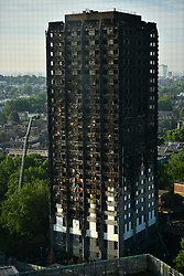 © Licensed to London News Pictures. 15/06/2017. London, UK. The scene the day after the  a huge fire at a Grenfell tower block in west London. The blaze engulfed the 27-storey building with hundreds of firefighters attending the scene. Photo credit: Ben Cawthra/LNP