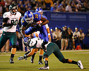 San Jose State Spartans running back JASON SIMPSON (32) leaps over Sacramento State Hornets defensive back ROBERT BEALE (29) during the season opener at San Jose State University's Spartan Stadium in San Jose, California, on August 29, 2013. The San Jose State Spartans beat the Sacramento State Hornets 24-0. (Stan Olszewski/ZUMA Press)