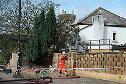 © London News Pictures. 28/10/2013 . London, UK.  Emergency services at the scene where a gas explosion at a house was caused by a falling tree in heavy wind, hospitalising at least three people. Gusts of 99mph have been recorded as a storm continues to batter parts of England and Wales. Photo credit : Ben Cawthra/LNP