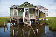 Abandoned fishing camps destroyed by Hurricane Rita in the marsh between Isle de Jean Charles and Pointe-Aux-Chien in Terribone Parish Louisiana. The Island is under constant threat of flooding due to coastal erosion.