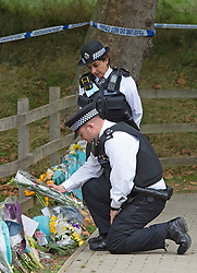 © Licensed to London News Pictures 23/09/2021. Kidbrooke, UK, Police officers reading the messages on the flowers. A large police cordon is still in place around Cator Park at Kidbrooke Village in Kidbrooke, South East London today after the body of 28 year old school teacher Sabina Nessa was found near a community centre. Police have said Sabina left her home and walked through Cator Park heading for the Depot pub at Pegler Square in Kidbrooke Village to meet a friend. Photo credit:Grant Falvey/LNP