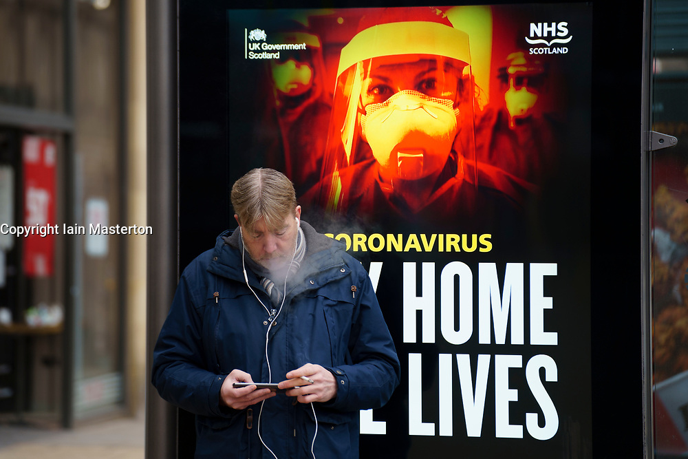 Edinburgh, Scotland, UK. 13 January 2020. Views of virtually empty Princes Street in Edinburgh with Covid-19 health warning displays on bus shelters. Almost all shops have ceased click and collect services so very few shoppers are out during lockdown. Iain Masterton/Alamy Live News