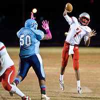 102612       Brian Leddy<br /> Monument Valley Mustang Delmar Redmond (7) throws a pass during Friday's game against Window Rock.