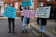 Protesters hold signs at a Free Palestine SOS Colombia rally in solidarity with the Palestinian and Colombian peoples outside the Colombian embassy on 15th May 2021 in London, United Kingdom. Speakers at the event, which took place on Nakba Day and also included a march to the Israeli embassy, highlighted human rights abuses being directed against Palestinians in Israel and the Occupied Territories, in particular attempts at forced displacements in Sheikh Jarrah in East Jerusalem, and also in Colombia, where peaceful demonstrators and human rights defenders have been killed and subjected to repression, detention and torture.