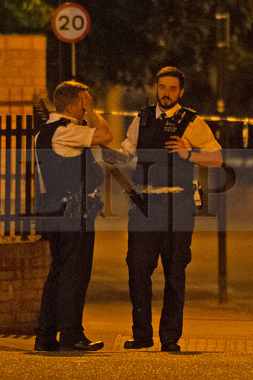 © Licensed to London News Pictures 01/06/2021. Hither Green, UK. A police officer looking distressted at the scene. A 23 year old man has been stabbed in the face in Hither Green, Lewisham in London this evening police are on scene and a cordon is in place. The man is in a life threating condition in hospital. Photo credit:Grant Falvey/LNP