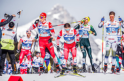 03.03.2019, Seefeld, AUT, FIS Weltmeisterschaften Ski Nordisch, Seefeld 2019, Langlauf, Herren, 50 km Massenstart, im Bild Athleten bei der Verpflegung // Athletes during the men's cross country 50 km mass start competition of FIS Nordic Ski World Championships 2019. Seefeld, Austria on 2019/03/03. EXPA Pictures © 2019, PhotoCredit: EXPA/ JFK
