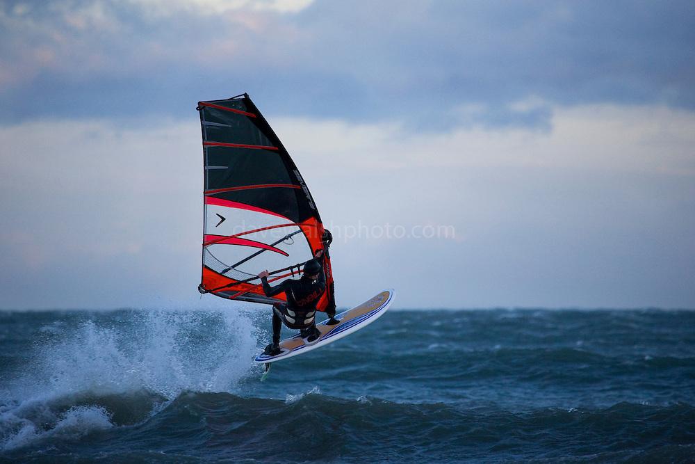 Windsurfer flies through the air, Dollymount Beach, Bull Island, Dublin, Ireland