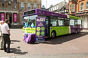 Public promotion publicity event for bus service in central Ipswich, Suffolk, England, UK