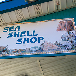 Rehoboth Beach, DE, USA - March 11, 2012: A Sea Shell shop sign on the boardwalk in Rehoboth Beach, Delaware.