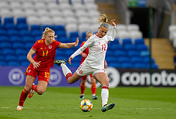 CARDIFF, WALES - Tuesday, April 13, 2021: Denmark's Stine Larsen (R) gets away from Wales' Ceri Holland during a Women's International Friendly match between Wales and Denmark at the Cardiff City Stadium. (Pic by David Rawcliffe/Propaganda)