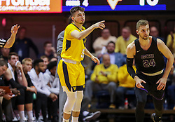 Mar 20, 2019; Morgantown, WV, USA; West Virginia Mountaineers guard Jordan McCabe (5) celebrates after a made three pointer during the first half against the Grand Canyon Antelopes at WVU Coliseum. Mandatory Credit: Ben Queen
