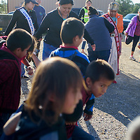 Miss Ramah Navajo Princess Tenisha Alonzo, right, leads the crowd in stretching to prepare for a 3-mile health walk in Pine Hill Thursday.