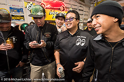 Visitors from Thailand at the Monday night afterparty at Mooneyes Area One after the Mooneyes Yokohama Hot Rod & Custom Show. Yokohama, Japan. December 5, 2016.  Photography ©2016 Michael Lichter.