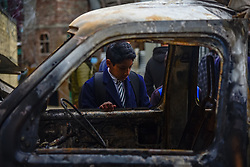 March 28, 2019 - Srinagar, Jammu and Kashmir, India - A Kashmiri school boy seen inspecting a damaged vehicle after a blast in Srinagar..Reports said that panic gripped in Alochi Bagh area of Srinagar when a mysterious blast took place near Indian army camp in the area. A house and a parked vehicle were damaged due to the impact of the blast. (Credit Image: © Idrees Abbas/SOPA Images via ZUMA Wire)
