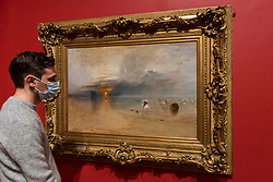 "© Licensed to London News Pictures. 26/10/2020. LONDON, UK. ""Calais Sands at Low Water: Poissards Collecting Bait"", 1830, by JMW Turner. Preview of ""Turner's Modern World"", a new landmark exhibition of over 150 works exhibition by JMW Turner at Tate Britain, 28 October to 7 March 2021.  Photo credit: Stephen Chung/LNP"