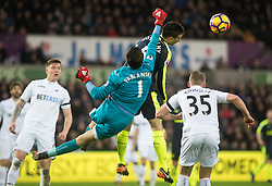 SWANSEA, WALES - Saturday, January 14, 2017: Swansea City's Lukas Fabianski in action against Arsenal Laurent during the FA Premier League match at the Liberty Stadium. (Pic by Gwenno Davies/Propaganda)