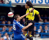Photo: Daniel Hambury.<br />Chelsea v Manchester City. The Barclays Premiership. 20/08/2006.<br />Chelsea's John Terry and City's Georgios Samaras compete for the ball.