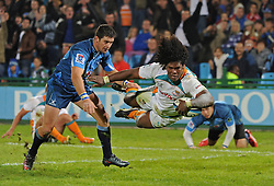 PRETORIA, South Africa, 28 May 2011. Ashley Johnson of the Cheetahs hands-off Morne Steyn of the Bulls to go over for one of his tries during the Super15 Rugby match between the Bulls and the Cheetahs at Loftus Versfeld in Pretoria, South Africa on 28 May 2011..Photographer : Anton de Villiers / SPORTZPICS