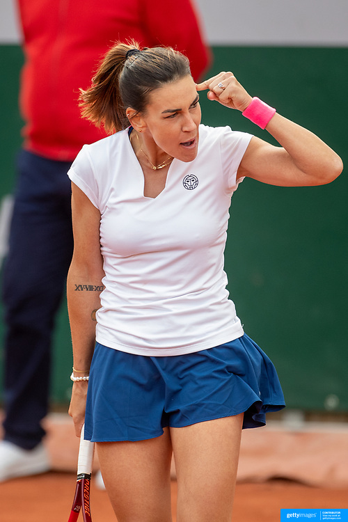 PARIS, FRANCE May 26.  Nuria Parrizas Diaz of Spain celebrates her victory against Sara Errani of Italy on day three of the qualifying tournament at the 2021 French Open Tennis Tournament at Roland Garros on May 26th 2021 in Paris, France. (Photo by Tim Clayton/Corbis via Getty Images)