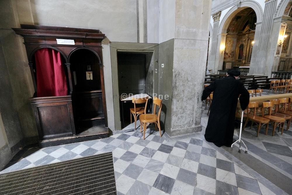 elderly priest leaving his confessional, Duomo, Città di Castello, Umbria, Italy