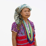 Portrait of a Karen Pwo ethnic minority woman wearing traditional clothing at Mae Lay village, Chiang Mai province, Thailand
