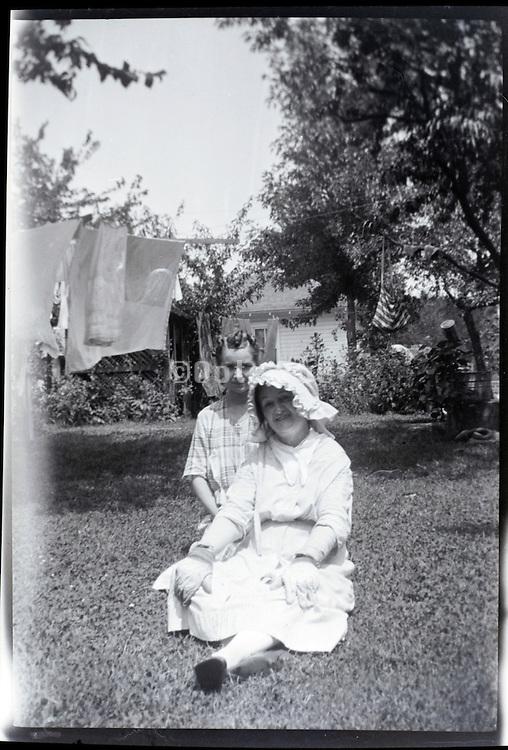 happy smiling adult women in backyard USA 1920s