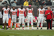 The Kansas City Chiefs stand during the playing of the National Anthem before the 2016 NFL week 6 regular season football game against the Oakland Raiders on Sunday, Oct. 16, 2016 in Oakland, Calif. The Chiefs won the game 26-10. (©Paul Anthony Spinelli)