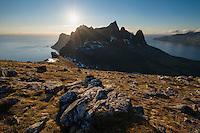 Summer sun over mountain peaks from Hesten, Senja, Norway
