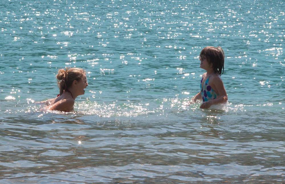 Olivia and Eliza Swimming in Diablo Lake, North Cascades National Park, Washington, US