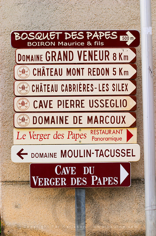 Signs pointing to wine producers: Bosquets des Papes Boiron Maurice, Domaine Grand Veneur, Mont Redon, Cabrieres Les Silex, Pierre Usseglio, de Marcoux, Verger des Papes, Moulin Tacussel Chateauneuf-du-Pape Châteauneuf, Vaucluse, Provence, France, Europe Chateauneuf-du-Pape Châteauneuf, Vaucluse, Provence, France, Europe