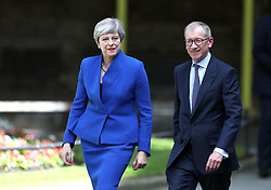 Prime Minister Theresa May, accompanied by her husband Philip, arrives to make a statement in Downing Street after she traveled to Buckingham Palace for an audience with Queen Elizabeth II following the General Election results.