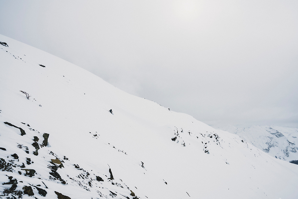 Torrey Udall skis northwest from the highest point in the Esplanade Range, Cupola Mountain (2632m), British Columbia