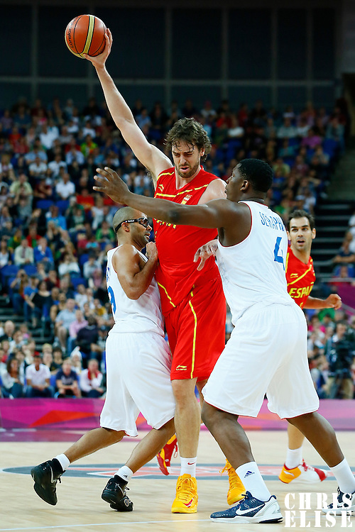 08 August 2012: France Tony Parker and Kevin Seraphin defend on Spain Pau Gasol during 66-59 Team Spain victory over Team France, during the men's basketball quarter-finals, at the 02 Arena, in London, Great Britain.