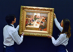 © Licensed to London News Pictures. 17/05/2013. London, UK Staff hang ALBERT EDELFELT. FINNISH. 1854 - 1905. THE BOYS' WORKHOUSE, HELSINKI.Estimate: 350,000 - 450,000 GBP.A photo call for a preview of 19th Century European Paintings held at Sotheby's London today 17th May 2013. The paintings will be offered to auction on 23 May 2013. Photo credit : Stephen Simpson/LNP