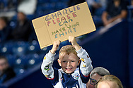 A little boy holds up his sign asking for Charlie Austins shirt during the EFL Sky Bet Championship match between West Bromwich Albion and Queens Park Rangers at The Hawthorns, West Bromwich, England on 24 September 2021.