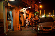 Women stand outside of a brothel in Cartagena, Colombia, where prostitution is legal. A sex scandal erupted recently when secret service agents were found bringing prostitutes to their hotel rooms while in Cartagena preparing for President Barack Obama's arrival to the Summit of the Americas.