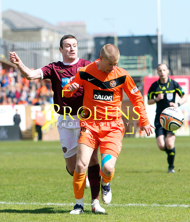 SPL Dundee United FC v  Hearts FC Scottish Premier League Season 2011-12.28-04-12...Dundee United's Richie Ryan holds off Hearts Stephen Elliott       during the Scottish premier League clash between Euro spot chasing Dundee United FC and Heart of Midlothian FC...At Tannadice Stadium, Dundee..Saturday 28th April 2012.Picture Mark Davison/ Prolens Photo Agency / PLPA
