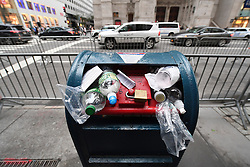 With garbage cans removed for security reasons, pedestrians put their trash atop locked mailboxes along 5th Avenue during the second day of Anti-Trump protest during President Donald Trump's first stay in New York City since taking office, New York, NY, on August 15, 2017. (Photo by Anthony Behar)