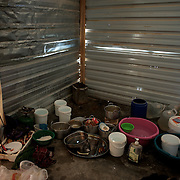 August 12, 2013 - Zaatari, Jordan: View of the improvised kitchen area at Mahmoud Amarin's tent in Zaatari refugee camp in northern Jordan. Mahmoud Amarin, a 70 year old syrian bus driver from Daraa city, fled the fighting in Syria one year ago, when his house got shelled by the regime forces. Like many other refugees in Zaatari, Mr. Amarin lost two of his children during the attack to his village, leaving behind all his worldly possessions. He lives now at the camps with his wife and two children, and depends uniquely on basic aid provided by international Non-Governmental Organisations. Mr. Amarin intends to go back to his hometown soon, due to the harsh life refugees endure at camp. Zaatari camp, home to more than 120,000 people who in the past year have fled the conflict in Syria, become the fourth largest city in Jordan and the world's second largest refugee camp behind Dadaab in eastern Kenya. Most of its residents came from Daraa, a city about 30Km away in Syria, rich with businessmen thanks to a long history of cross-border trade with Jordan. (Paulo Nunes dos Santos/Al Jazeera)